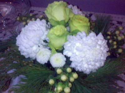 green roses, white zinnias, chrysanthemums and berries, cedar and pine boughs - click to enlarge