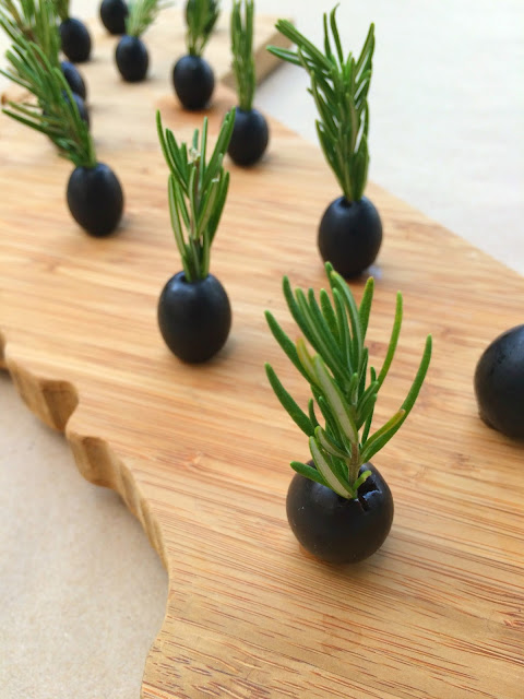 Olive Christmas Tree Appetizers - Topped with Rosemary and stuffed with Manchego Cheese | www.jacolynmurphy.com