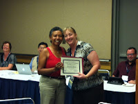 Leslie Reynolds presenting the SLA IT Divisionoutstanding member award to Jill
