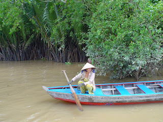 Vietnamese boatman sitting squat