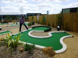 Photo of Richard Gottfried playing the Peterborough Minigolf course at Dobbies Garden Centre