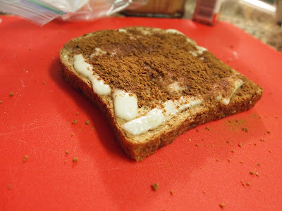 a layer of cinnamon sugar on top of melted mozzarella after the bread and the cheese came out from the oven