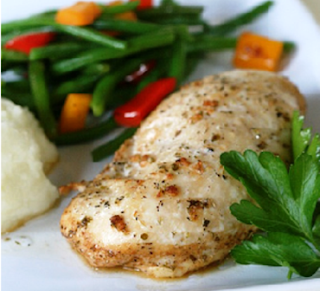Picture of Grilled Chicken on a white plate with vegetables
