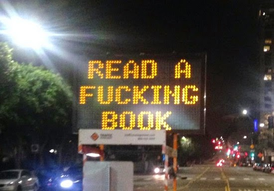 los angeles road sign hacked read a fucking book