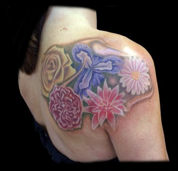 Daisy Flower Tattoo on back shoulder blade