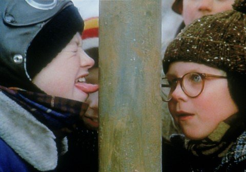 Flick with his tongue stuck to the flagpole in A Christmas Story 1983 movieloversreviews.blogspot.com
