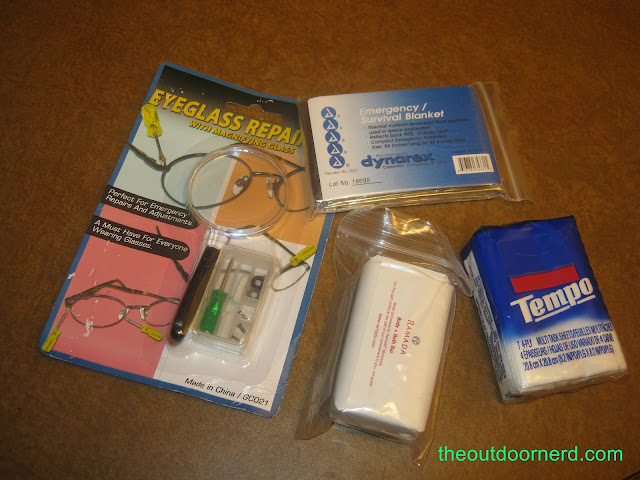 Car survival kit emergency blanket, eyeglass kit, soap and tissues
