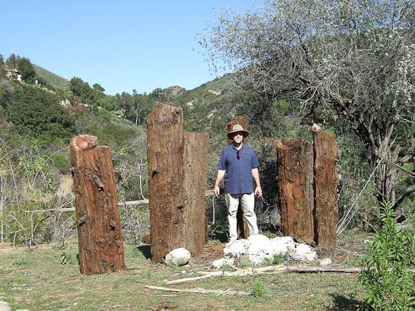 James standing in front of salvaged redwood in Topanga, CA