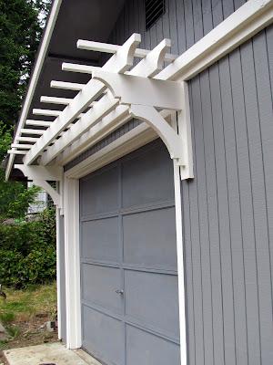 garage door arborblue roof cabin DIY Trellis Over the Garage Door
