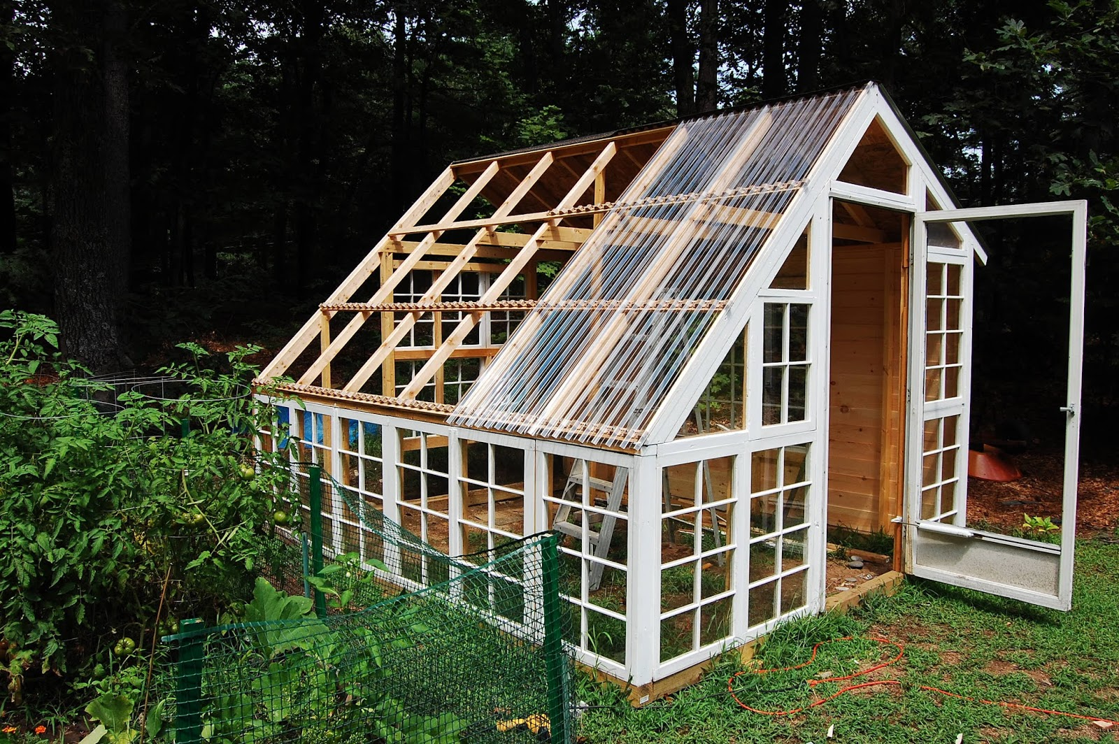 Custom backyard greenhouse with recycled windows december for Reclaimed window greenhouse