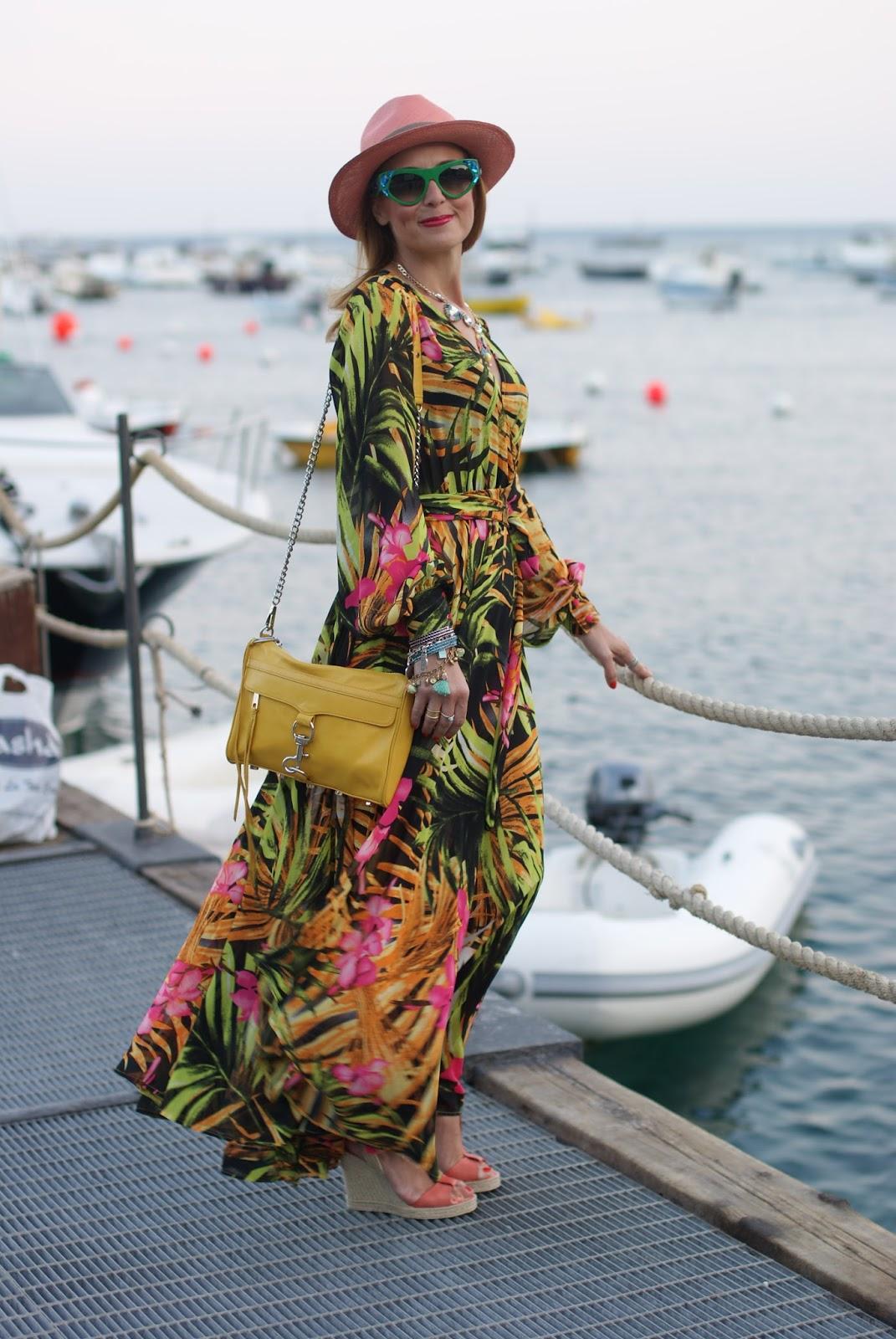amalfi coast style with a tropical print chiffon maxi dress, ecua-andino hat for a summer boho style on Fashion and Cookies fashion blog, fashion blogger style