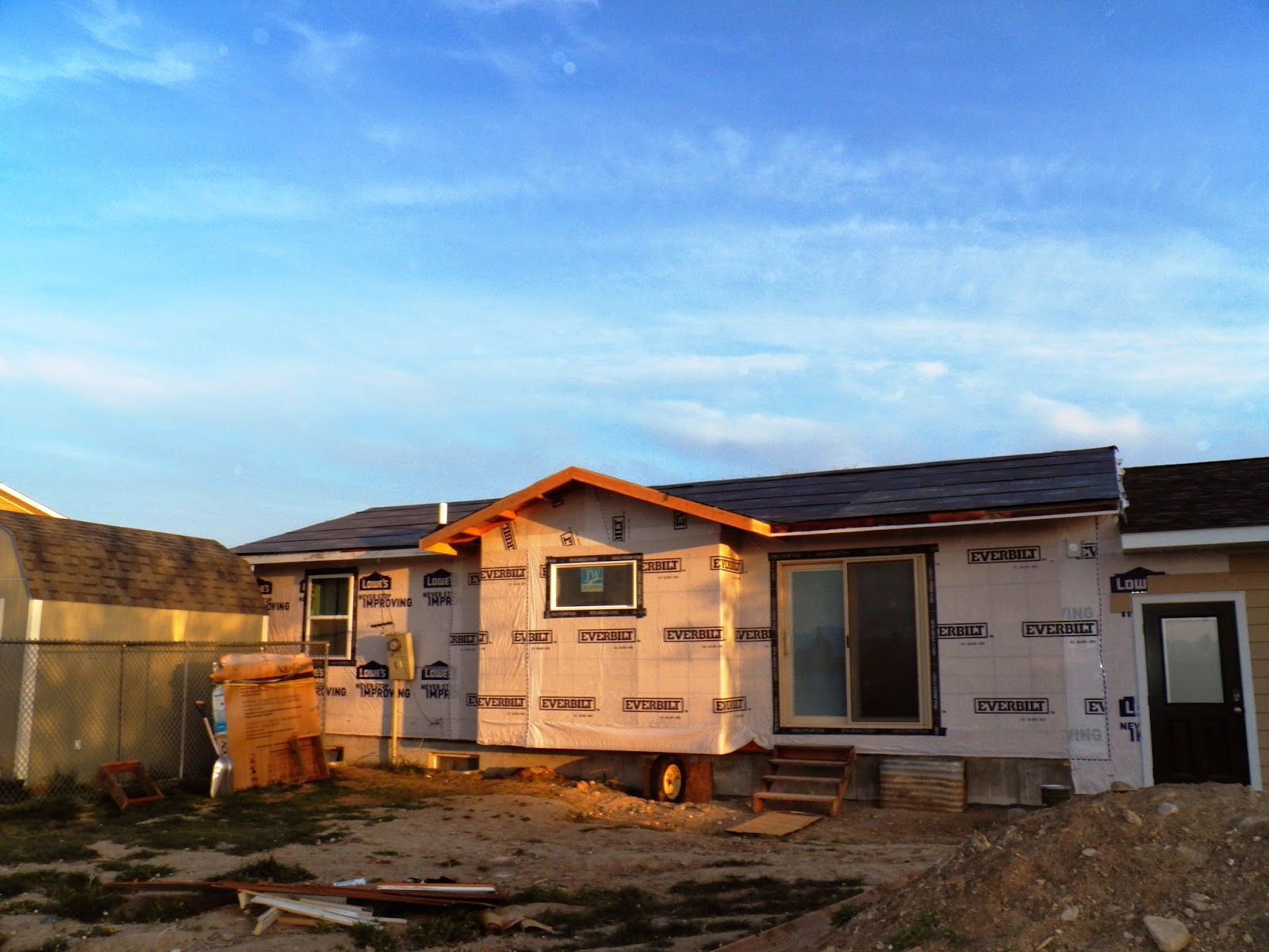 Wrapping up the back for Sheathing house wrap