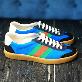 Gucci multi-colored sneakers.