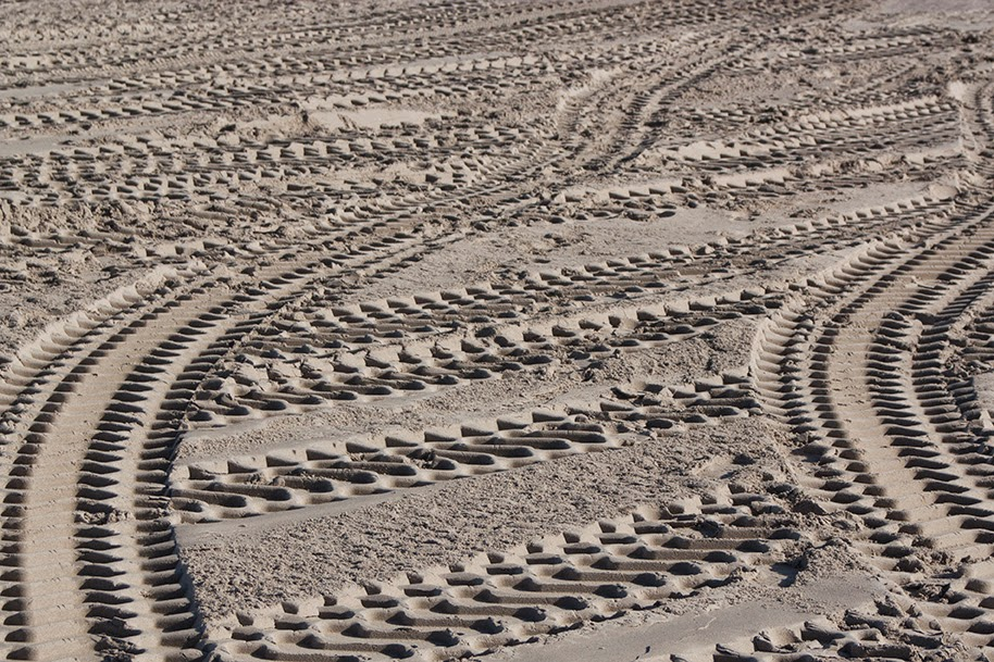 pattern of tire prints in sand