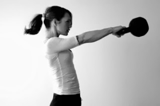 Image of a client performing the kettlebell swing for the core