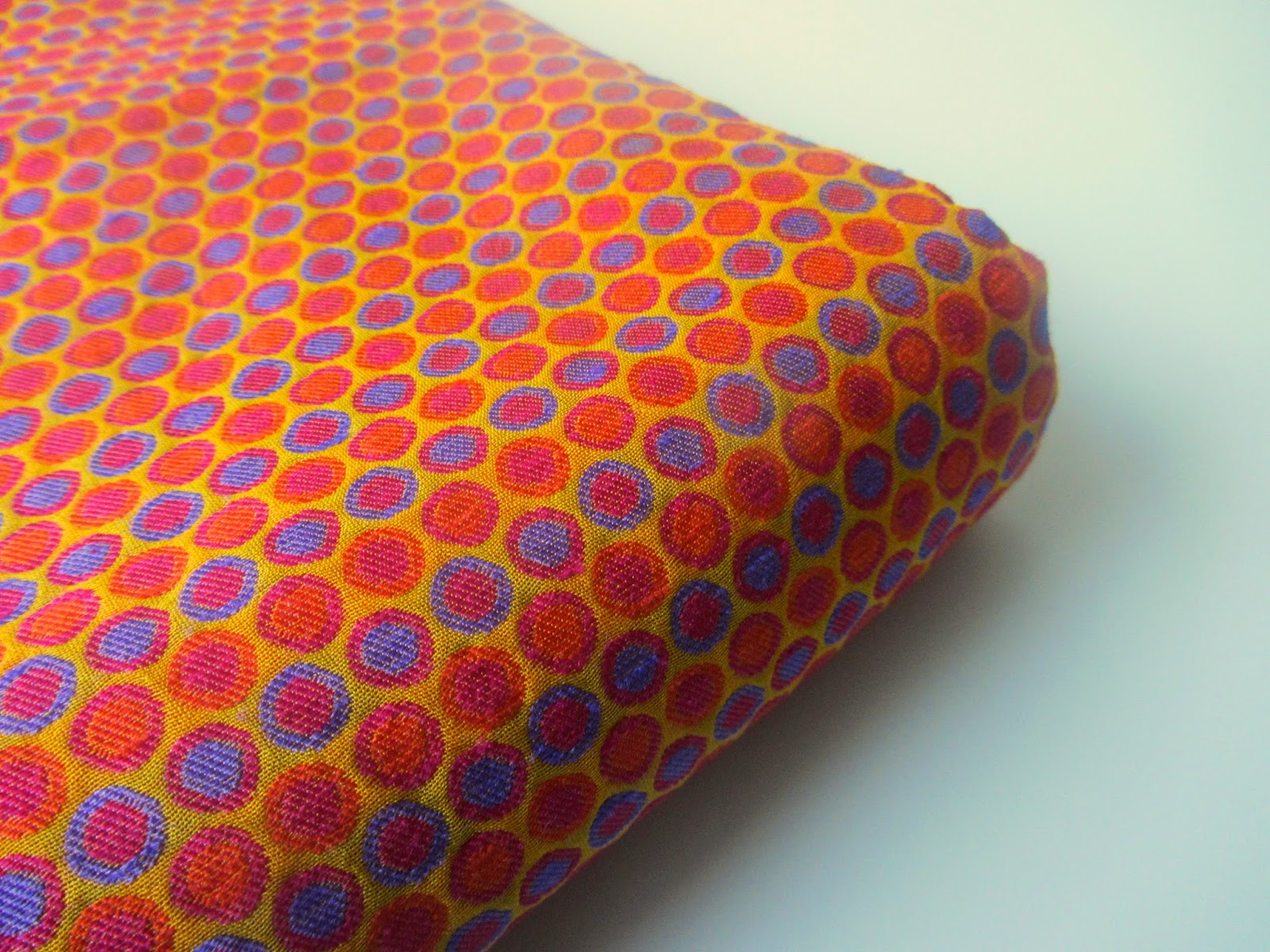 Orange blue two tone polka dots India silk brocade fabric