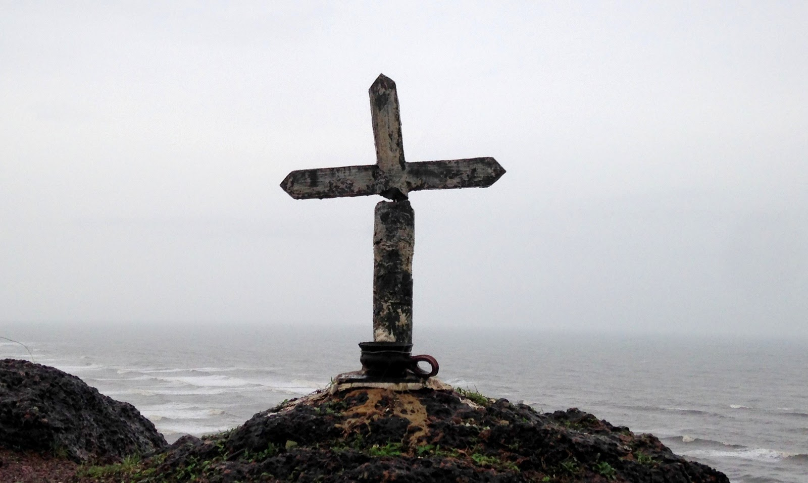 A small cross installed atop the hill