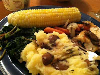 callalloo side dish served with mashed potatoes, corn and chicken