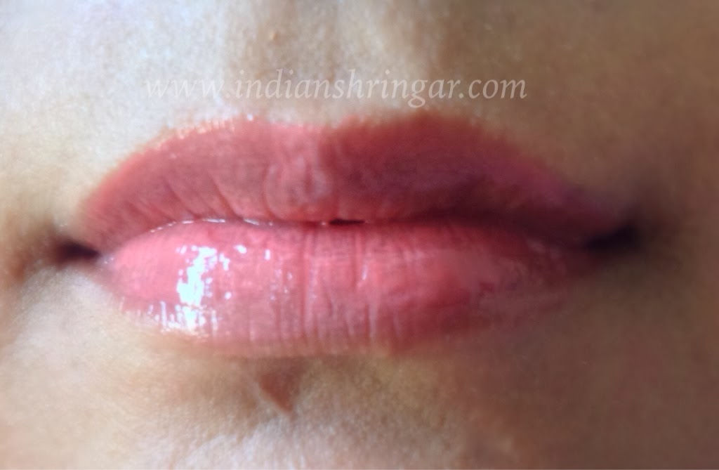 Lip swatch of Maybelline Lip Polish Glam7 on NC40 skintone