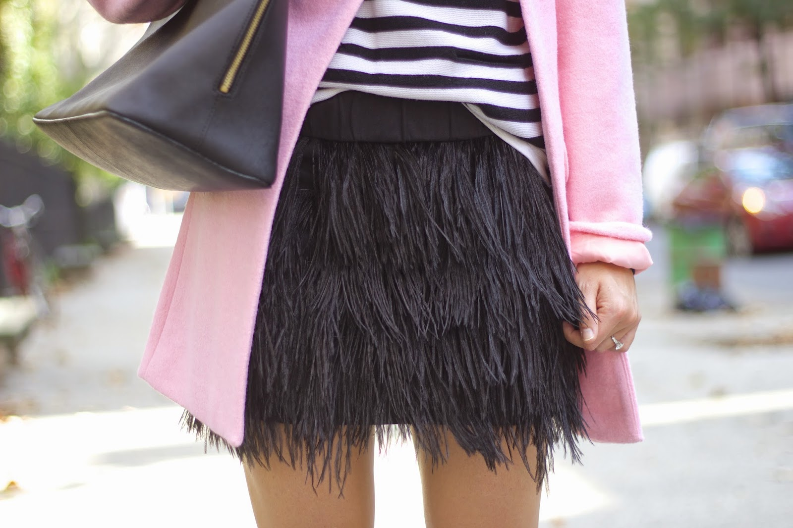 pink coat, black and white stripe sweater, feather skirt, fall fashion trends