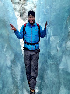 Simon standing in an ice crevasse on the Fox glacier, New Zealand