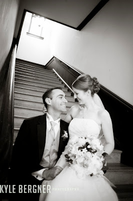 Bride and Groom seated on steps at Chase Court