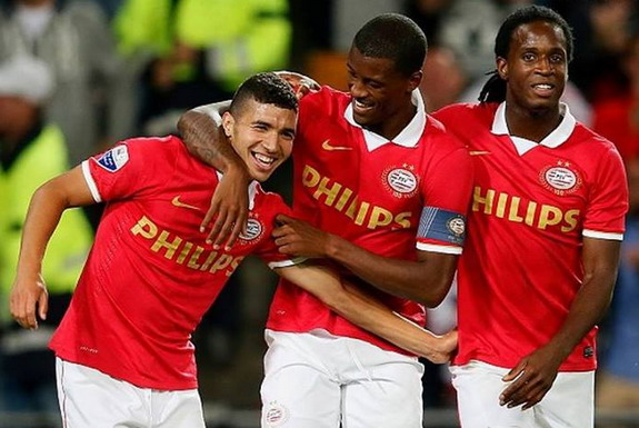 Zakaria Bakkali celebrates with PSV teammates after scoring a goal against NEC