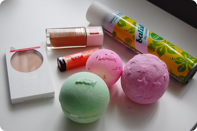 Revlon Nearly Naked Foundation in Natural Beige, Revlon Nearly Naked Pressed Powder, Revlon Lip Butter in Juicy Papaya, Batiste Dry Shampoo in Tropical, Lush Avobath bath bomb, Lush Rose Queen Bath Bomb, Lush Twilight Bath Bomb.