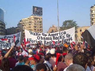 Wake up America, Obama backs up a fascist regime in Egypt banner during an Egyptian protest