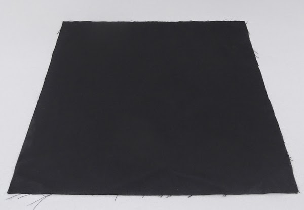 black fabric, a piece of black fabric,