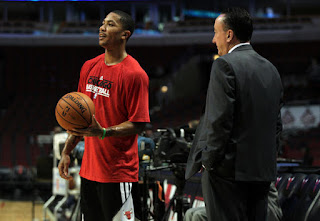 The Bulls' Derrick Rose and general manager Gar Forman before Monday's game against Charlotte at the United Center.(January 29, 2013)