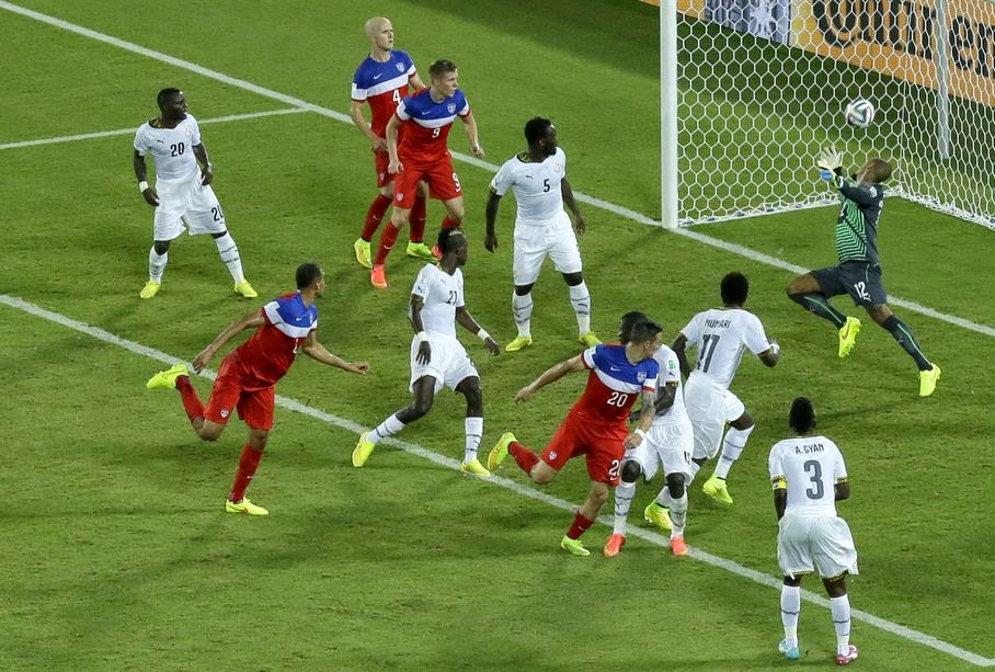 United States' John Brooks, second from left, scores his side's second goal during the group G World Cup soccer match between Ghana and the United States at the Arena das Dunas in Natal, Brazil, Monday, June 16, 2014. The United States defeated Ghana 2-1.