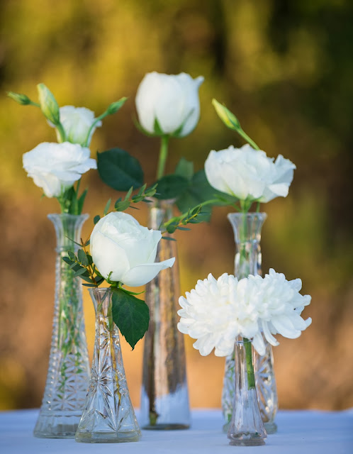 cut crystal vases with flowers