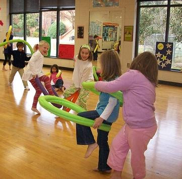 Pine Street 3rd graders using swim noodles as props in dance class