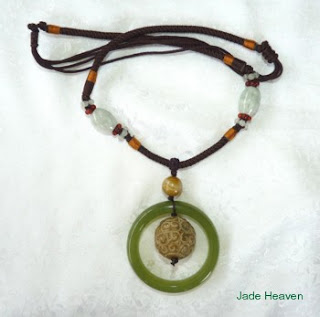 https://jadeheaven.com/collections/featured-collection/products/double-heaven-jade-bangle-necklace-with-carved-round-ball