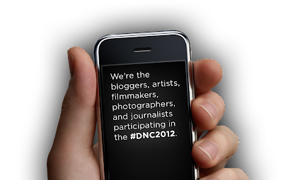 "[Description: Hand holding a cellphone with following words: ""We're the bloggers, artists, filmmakers, photographers, and journalists participating in the #DNC2012"