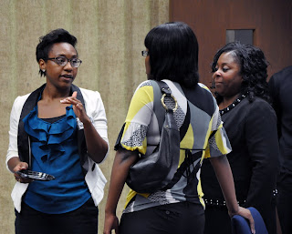 Candice Williams (MA '11), a counselor with Children's Safe Harbor (l), and Georgia Haynes, Senior Court Officer with Tarrant County Adult Probation (r) visit with a student at an NABCJ gathering.