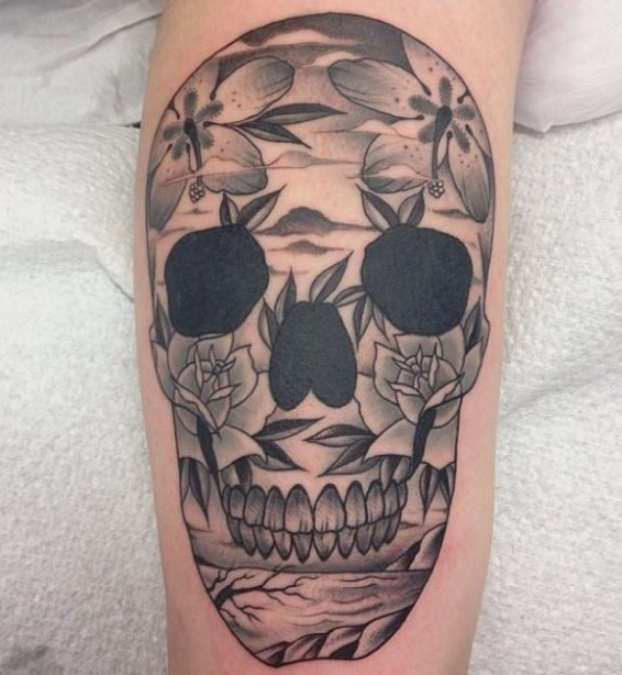 Awesome skull with flowers tattoo