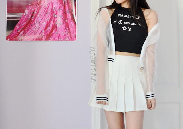 A monochromatic ulzzang outfit featuring Dresslink's sheer striped bomber jacket and halter crop top, worn with a white pleated American Apparel tennis skirt.