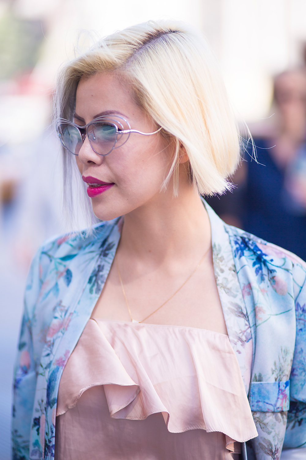 Crystal Phuong- New York Fashion Week Day 5 in a floral pantsuit and Ederm sunglasses