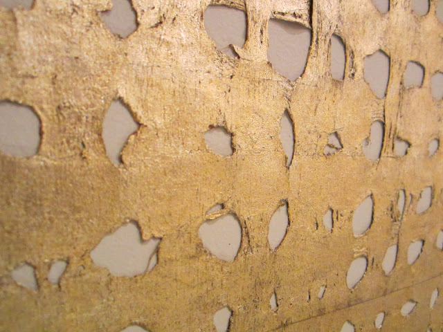 Close up of the gold wall covering by Kneedler-Fauchere