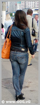 Girl in jeans on the bus station