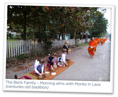 Marla Malcolm Beck – The Beck Family – Morning Alms with Monks in Lao (centuries old tradition)