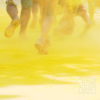 Runners run through yellow powder during the Color Me Rad 5K in Seoul, South Korea.