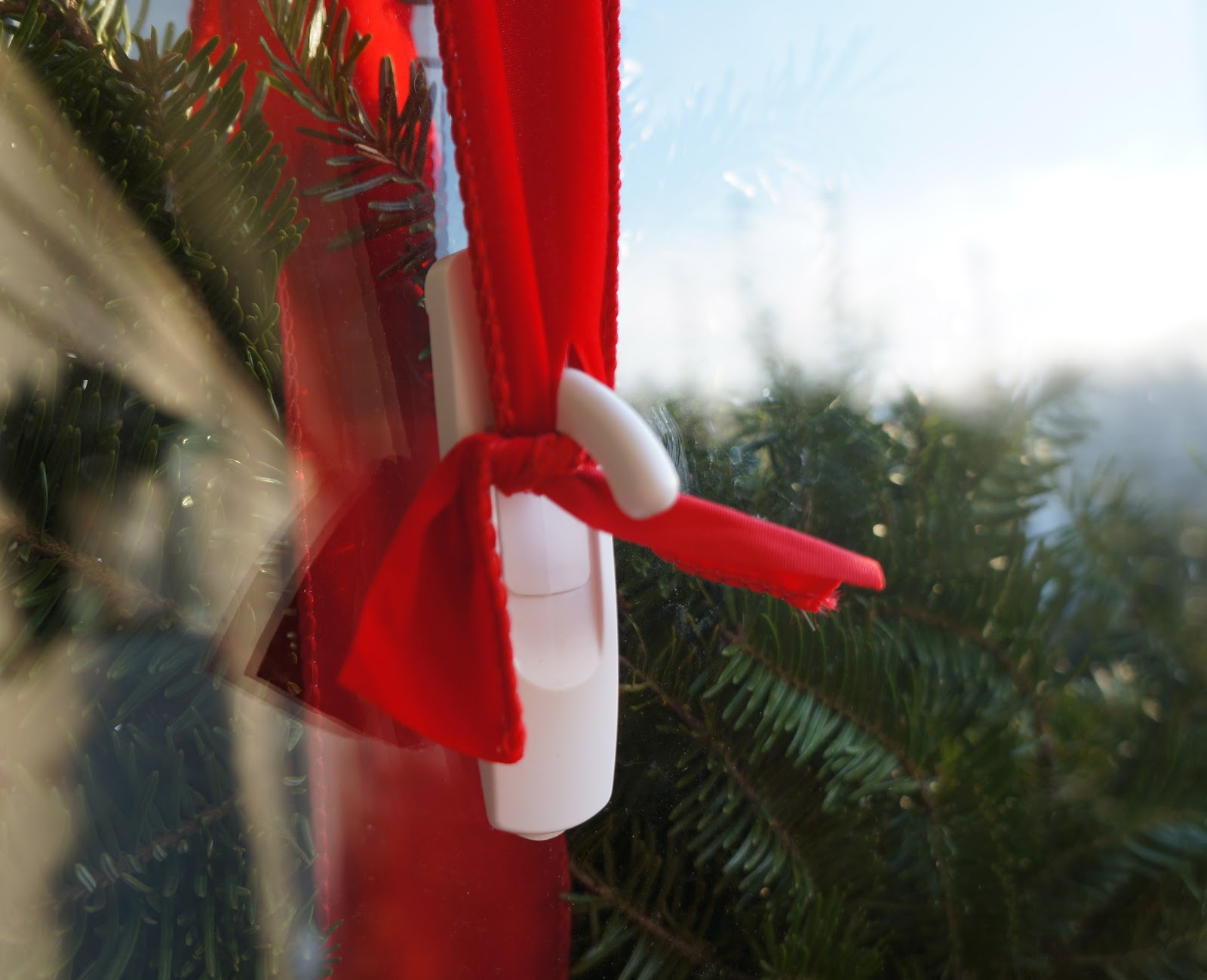 From There, I Affixed Thick Red Ribbon Around The Wreath And Left Enough Of  A Tail To Get It Over The Door.