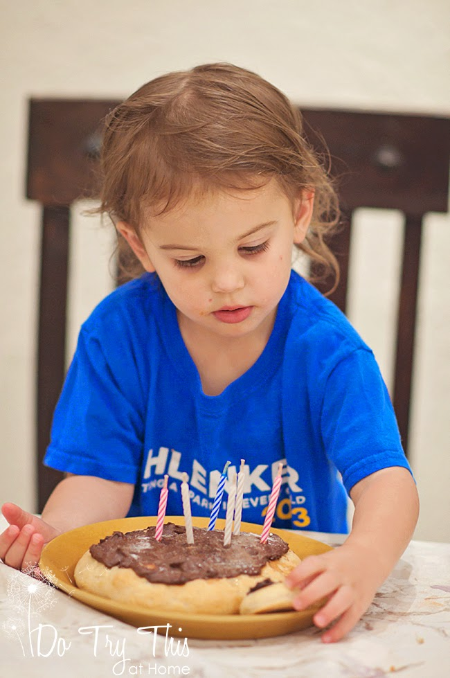 Chocolate birthday pizza with six candles for the third birthday