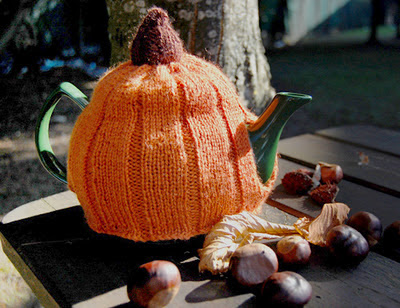 http://buttonsandbeeswax.com/patterns/free-knitting-patterns/halloween-pumpkin-tea-cosy/
