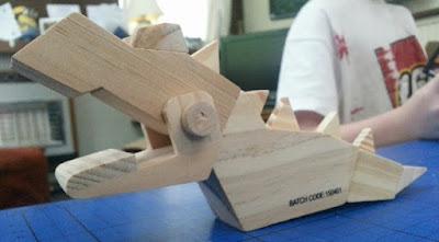 wooden T-Rex model