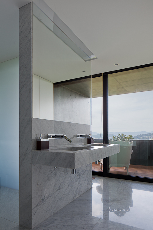 Marble sink in the bathroom of Black Concrete House by Pitagoras Arquitectos