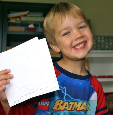 me too wanted everyone to see that he finished his shapes booklet he